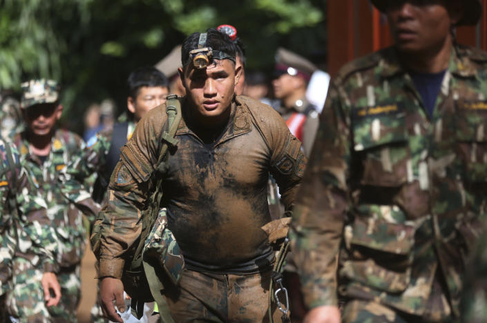 <p>Thai soldiers march from the Tham Luang Nang Non Cave in Chiang Rai Province, northern Thailand, June 29, 2018. Thailand's prime minister visited the flooded cave complex and urged relatives of the soccer players and their coach to not give up hope. (Photo: Sakchai Lalit/AP) </p>
