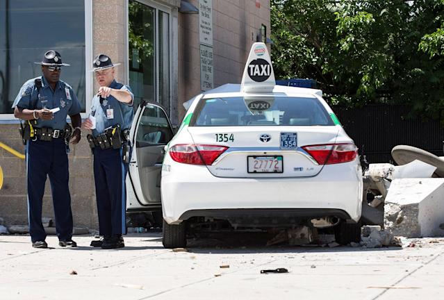 <p>State troopers look over the scene where a cab jumped a curb striking several bystanders near the Logan International Airport taxi pool in Boston, MA, July 3, 2017. (Keith Bedford/The Boston Globe via Getty Images) </p>