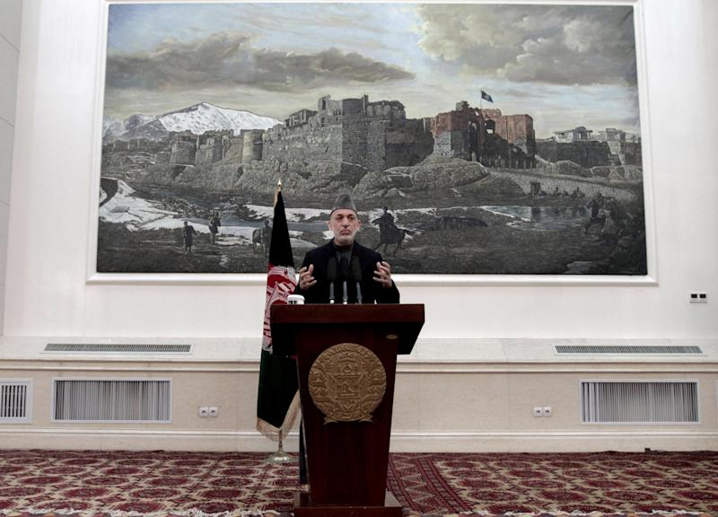Afghan President Hamid Karzai speaks during a news conference in Kabul, Afghanistan, Saturday, May 4, 2013. Karzai says the director of the CIA assured him that regular funding his government receives from the agency will not be cut off. He says Afghanistan has been receiving such funding for more than 10 years and expressed hope at a Saturday news conference that it will not stop. (AP Photo/Rahmat Gul)