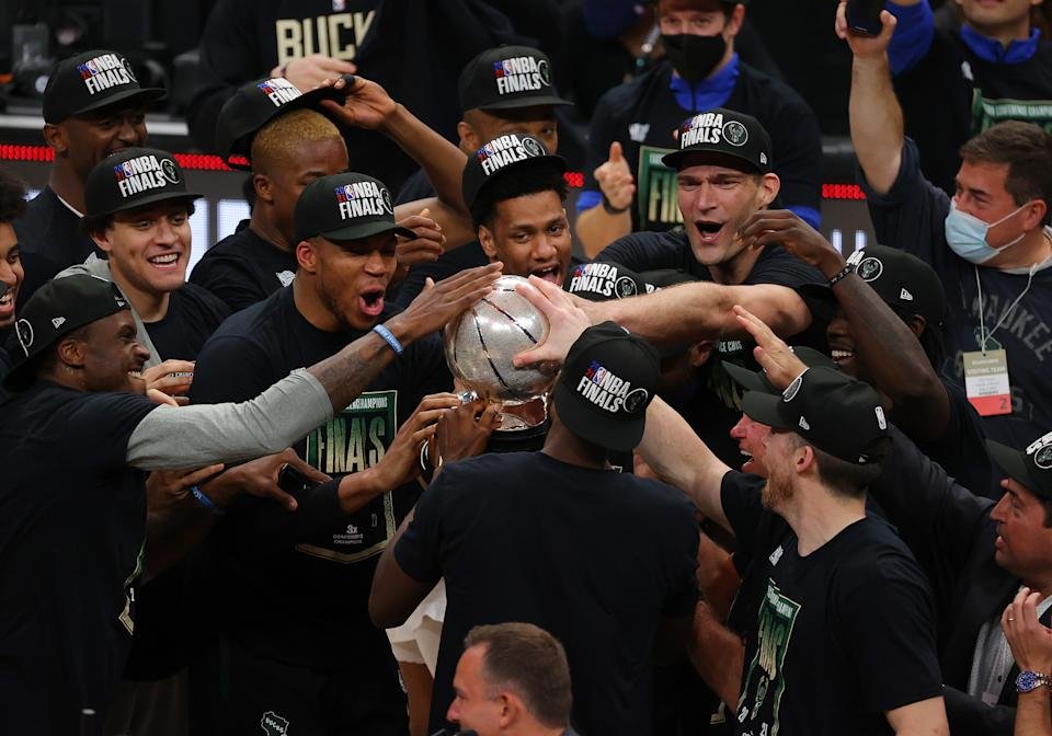 Members of the Milwaukee Bucks hold the Eastern Conference Finals trophy after defeating the Atlanta Hawks at State Farm Arena on July 03, 2021 in Atlanta, Georgia NOTE TO USER: User expressly acknowledges and agrees that, by downloading and or using this photograph, User is consenting to the terms and conditions of the Getty Images License Agreement. (Photo by Kevin C. Cox/Getty Images)