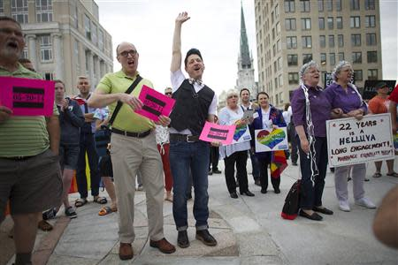 Gay rights supporters hold a rally on the Pennsylvania State Capital steps after a ruling struck down a ban on same sex marriage in Harrisburg, Pennsylvania, May 20, 2014. REUTERS/Mark Makela