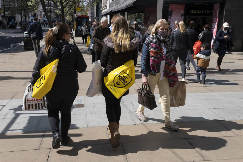Shoppers return to Oxford Street as non-essential shops reopen and the national coronavirus lockdown three eases on 12th April 2021 in London, United Kingdom. Now that the roadmap for coming out of the national lockdown has been laid out, this is the first phase of the easing of restrictions, and large numbers of people are out in London's retail district laden with shopping bags. (photo by Mike Kemp/In Pictures via Getty Images)