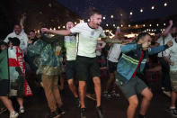Fans of England celebrate the second goal scored by Harry Kane at Luna Springs in Birmingham, England, while they watch the Euro 2020 soccer championship semifinal match between England and Denmark, remotely on Wednesday, July 7, 2021. (Jacob King/PA via AP)