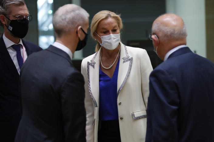 Netherlands' Foreign Trade Minister Sigrid Kaag, center, talks to France's Foreign Trade Minister Franck Riester, second left, and Portugal's Foreign Minister Augusto Santos Silva, right, during a European Foreign Trade ministers meeting at the European Council headquarters in Brussels, Thursday, May 20, 2021. (AP Photo/Francisco Seco, Pool)