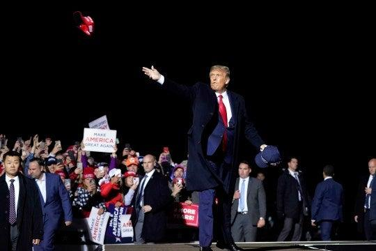 Trump coronavirus diagnosis: President threw MAGA hats into rally crowd one day before diagnosis