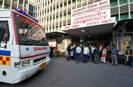An ambulance arrives as people stand at the entrance of the emergency department of a government-run hospital in New Delhi, India, November 22, 2017. Picture taken November 22, 2017. REUTERS/Saumya Khandelwal