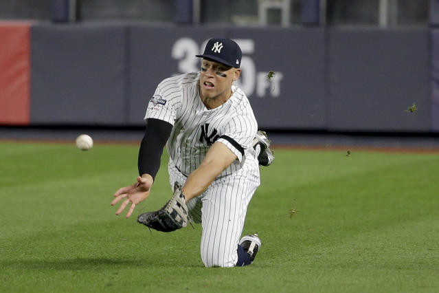 New York Yankees right fielder Aaron Judge makes a diving catch on a ball hit by Minnesota Twins' Jorge Polanco during the third inning of Game 1 of an American League Division Series baseball game, Friday, Oct. 4, 2019, in New York.(AP Photo/Seth Wenig)