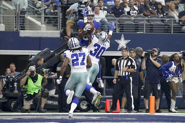 <p>New York Giants wide receiver Sterling Shepard (87) catches a touchdown against Dallas Cowboys cornerback Anthony Brown (30) in the second quarter at AT&T Stadium. Mandatory Credit: Tim Heitman-USA TODAY Sports </p>