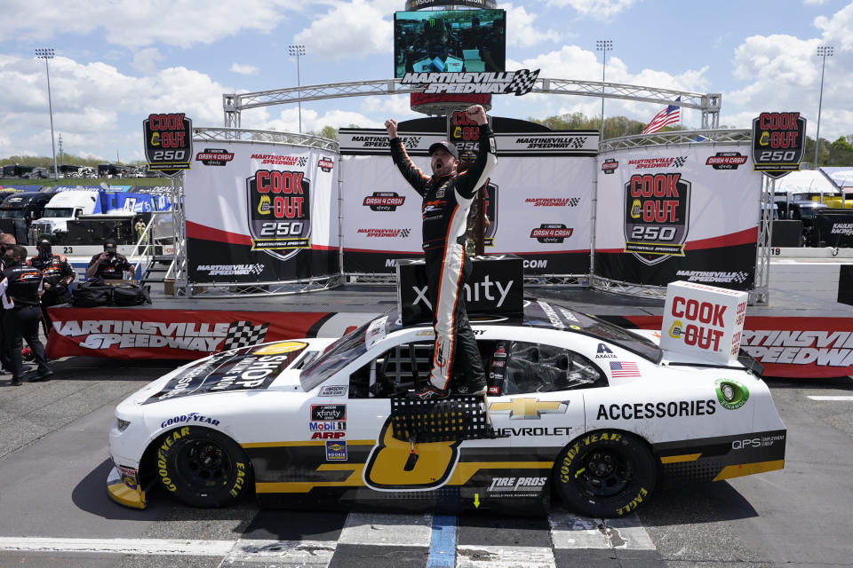 Josh Berry (8) celebrates winning the rain delayed NASCAR Xfinity Series auto race at Martinsville Speedway in Martinsville, Va., Sunday, April 11, 2021. (AP Photo/Steve Helber)