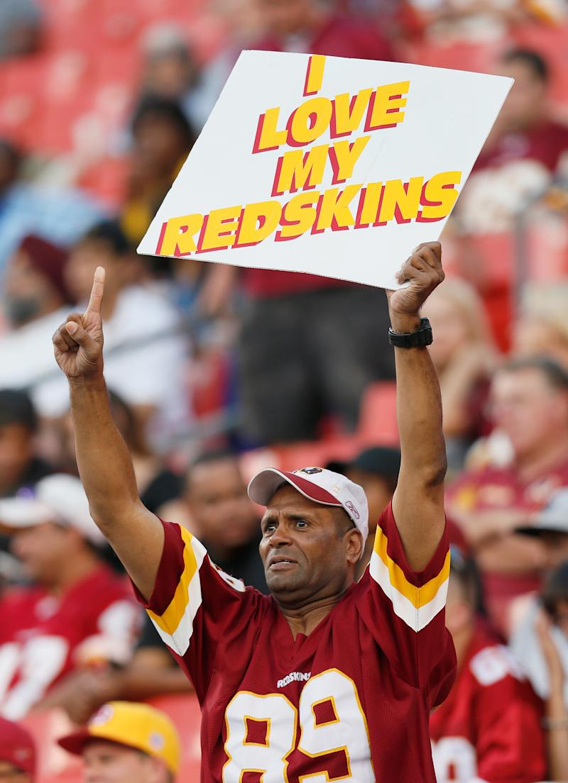 A fan holds up a sign during the Washington Redskins and Tampa Bay Buccaneers game at FedExField on August 29, 2012 in Landover, Maryland