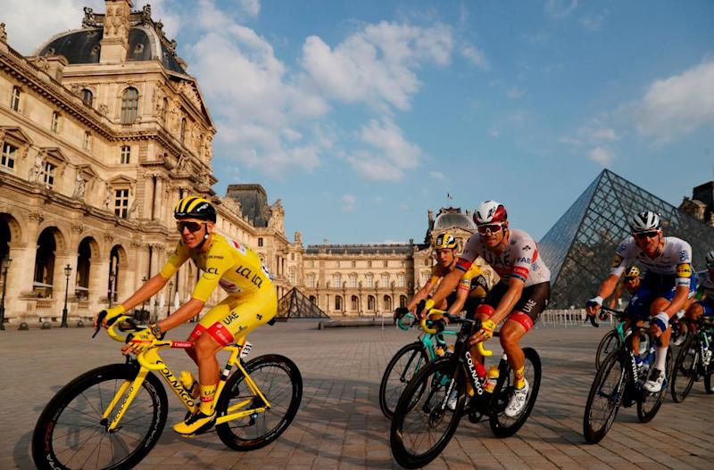 Team UAE Emirates rider Slovenias Tadej Pogacar 1stL wearing the overall leaders yellow jersey rides in the pack in front of the Louvre pyramid and museum during the 21st and last stage of the 107th edition of the Tour de France cycling race 122 km between ManteslaJolie and Champs Elysees Paris on September 20 2020 Photo by CHRISTIAN HARTMANN POOL AFP RESTRICTED TO EDITORIAL USE MANDATORY MENTION OF THE ARTIST UPON PUBLICATION TO ILLUSTRATE THE EVENT AS SPECIFIED IN THE CAPTION Photo by CHRISTIAN HARTMANNPOOLAFP via Getty Images