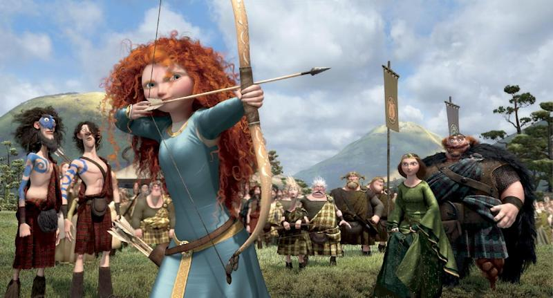 "This film image released by Disney/Pixar shows the character Merida, voiced by Kelly Macdonald, in a scene from ""Brave.""  The top spot at the box office is rare turf for Kelly Macdonald, a character actress known on the big-screen mainly for supporting roles in such films as ""No Country for Old Men"" and ""Finding Neverland.""  With her wild red mane and her killer skills with sword and bow, Macdonald has become the latest in Hollywood's growing line of successful female action heroes. (AP Photo/Disney/Pixar)"