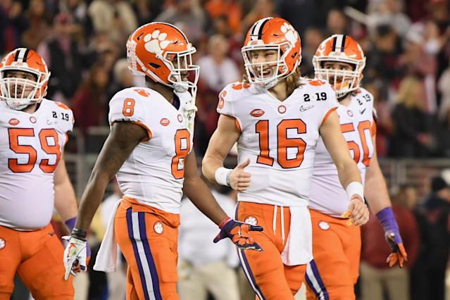 Justyn Ross (8) and Trevor Lawrence (16) of the Clemson Tigers react during their win over the Alabama Crimson Tide in the CFP National Championship. (Getty)
