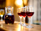 """<p>While a glass or two of wine might initially make you sleepy, <a href=""""http://psychcentral.com/news/2014/12/11/alcohol-use-can-impair-sleep-cause-insomnia/78498.html"""" rel=""""nofollow noopener"""" target=""""_blank"""" data-ylk=""""slk:alcohol actually disrupts your natural sleep patterns"""" class=""""link rapid-noclick-resp"""">alcohol actually disrupts your natural sleep patterns</a>. Regularly consuming alcohol (especially before bedtime) can worsen your sleep quality and also means you might wake up in the middle of the night and early in the morning to pee.</p>"""