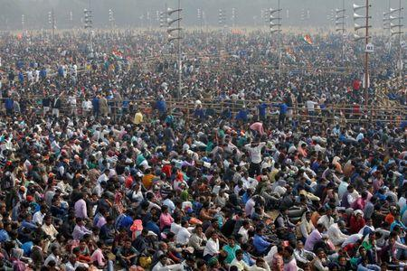 """FILE PHOTO: Supporters listen to speakers during """"United India"""" rally attended by the leaders of India's main opposition parties ahead of the general election, in Kolkata"""