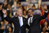 FILE - In this Oct. 29, 2008, file photo Vice presidential candidate Joe Biden, D-Del., left, and Democratic presidential candidate Sen. Barack Obama, D-Ill., right, wave during a rally at the Bank Atlantic Center in Sunrise, Fla. (AP Photo/Lynne Sladky, File)