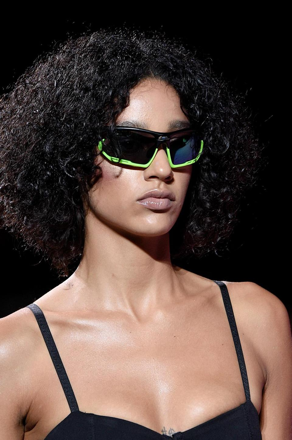 <p>A swagged out middle-parted mane with equally hot specs to match. (Photo: Getty Images) </p>