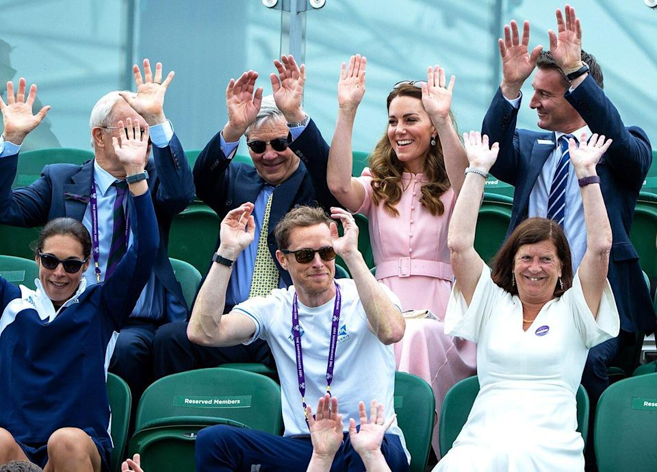 Catherine, Duchess of Cambridge is seen in the stands taking part in a Mexican wave during Day Thirteen of The Championships - Wimbledon 2021 at All England Lawn Tennis and Croquet Club on July 11, 2021 in London, England.