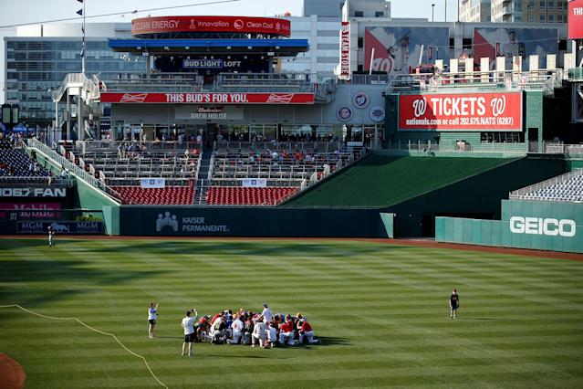<p>Members of the Republican team pray before the Democrats and Republicans face off in the annual Congressional Baseball Game at Nationals Park in Washington, June 15, 2017. (Photo: Joshua Roberts/Reuters) </p>