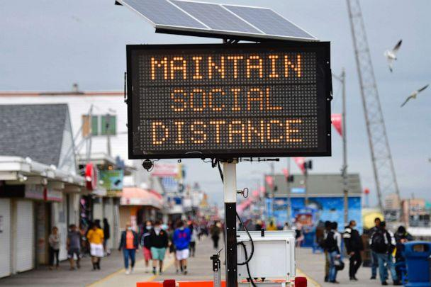 PHOTO: A sign placed on the boardwalk states 'MAINTAIN SOCIAL DISTANCE,' May 24, 2020, in Wildwood, New Jersey. (Mark Makela/Getty Images)