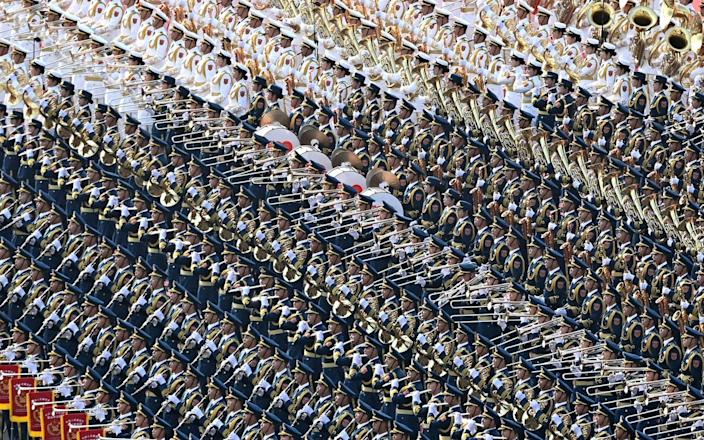 Members of the military band rehearse for a celebration marking the 100th founding anniversary of the Chinese Communist Party