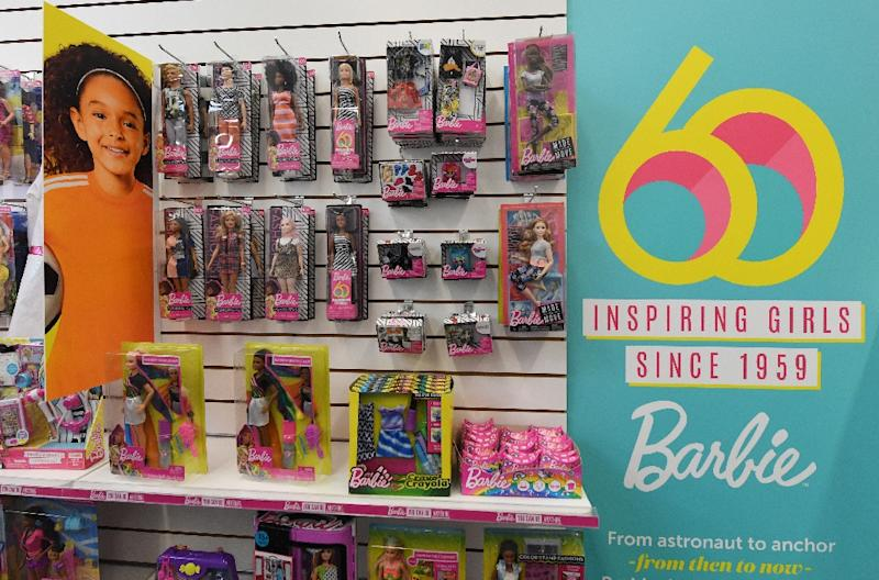 """Mattel scored a surprise fourth-quarter profit on strong sales of """"Barbie"""" and cost-cutting efforts"""