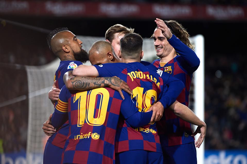 BARCELONA, SPAIN - MARCH 07: FC Barcelona players celebrate their opening goal scored by Lionel Messi during the Liga match between FC Barcelona and Real Sociedad at Camp Nou on March 07, 2020 in Barcelona, Spain. (Photo by Alex Caparros/Getty Images)