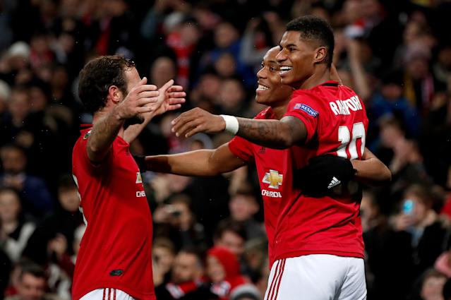 Anthony Martial celebrates his goal with Juan Mata and Marcus Rashford (Photo by Martin Rickett/PA Images via Getty Images)