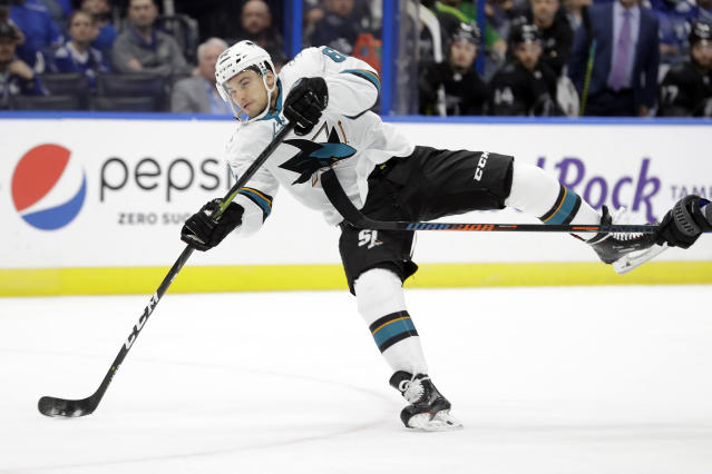 San Jose Sharks right wing Kevin Labanc (62) takes an off balance shot against the Tampa Bay Lightning during the first period of an NHL hockey game Saturday, Dec. 7, 2019, in Tampa, Fla. (AP Photo/Chris O'Meara)