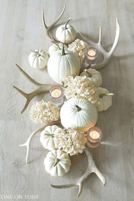 """<p>Fall decor isn't all about oranges, yellows, and reds. Dried hydrangeas and white, antler-like decorations can make for an equally gorgeous monochrome centerpiece. Candles bring warmth, and faux pumpkins add texture.</p><p><strong>Get the tutorial at <a href=""""http://toneontoneantiques.blogspot.com/2015/09/fall-accents.html"""" rel=""""nofollow noopener"""" target=""""_blank"""" data-ylk=""""slk:Tone on Tone"""" class=""""link rapid-noclick-resp"""">Tone on Tone</a>.</strong></p><p><a class=""""link rapid-noclick-resp"""" href=""""https://www.amazon.com/Luyue-Hydrangea-Artificial-Decoration-Champagne/dp/B01N3MWQ00?tag=syn-yahoo-20&ascsubtag=%5Bartid%7C10050.g.2130%5Bsrc%7Cyahoo-us"""" rel=""""nofollow noopener"""" target=""""_blank"""" data-ylk=""""slk:SHOP FAUX HYDRANGEAS"""">SHOP FAUX HYDRANGEAS</a></p>"""
