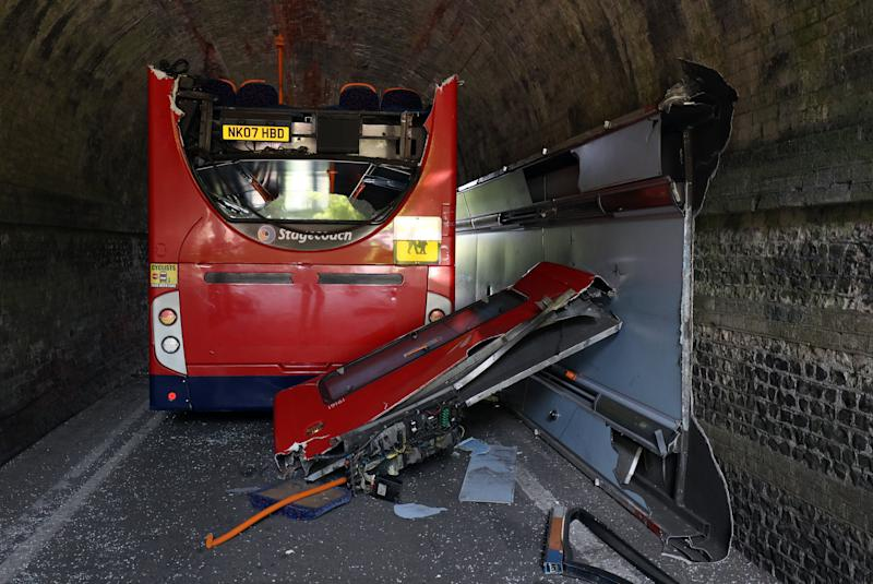 The scene on Well House Lane in Winchester after three children were taken to hospital with serious injuries while 12 others suffered minor injuries after the school bus they were travelling in crashed into a railway bridge.