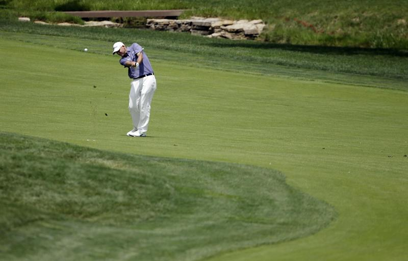 Bill Haas hits to the 18th green during the second round of the Memorial golf tournament Friday, May 31, 2013, in Dublin, Ohio. (AP Photo/Darron Cummings)