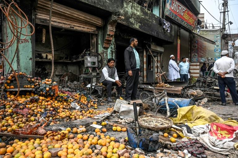A burnt-out and damaged shop in the riot-hit area of New Delhi is pictured on February 27