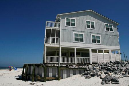 A retaining wall supports a beach house on the Gulf Coast at Cape San Blas, south of Port St. Joe, Florida, June 29, 2014. Picture taken June 29, 2014. REUTERS/Phil Sears