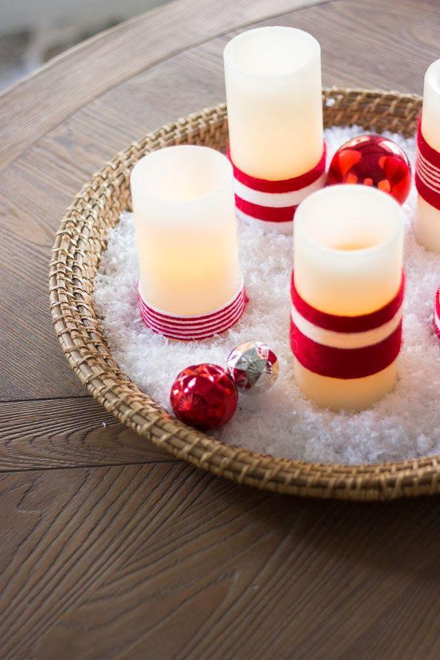 """<p>Seriously, it doesn't get any easier than this project! Wrap battery-operated candles with any color yarn. It's a great way to use up yarn scraps you might have left from another craft. </p><p><strong>Get the tutorial at</strong> <strong><a href=""""https://designimprovised.com/2013/12/christmas-candles.html"""" rel=""""nofollow noopener"""" target=""""_blank"""" data-ylk=""""slk:Design Improvised"""" class=""""link rapid-noclick-resp"""">Design Improvised</a>. </strong></p><p><a class=""""link rapid-noclick-resp"""" href=""""https://www.amazon.com/TYH-Supplies-Acrylic-Assorted-Colors/dp/B00XLP2UGI/ref=sr_1_5?dchild=1&keywords=yarn&qid=1600886878&sr=8-5&tag=syn-yahoo-20&ascsubtag=%5Bartid%7C10050.g.23489557%5Bsrc%7Cyahoo-us"""" rel=""""nofollow noopener"""" target=""""_blank"""" data-ylk=""""slk:SHOP YARN"""">SHOP YARN</a></p>"""