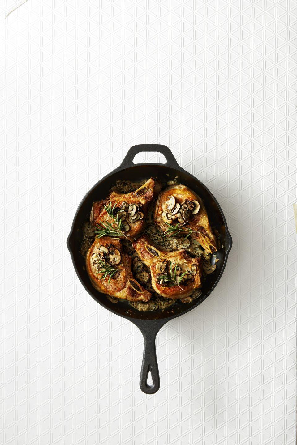 "<p>A few spoonfuls of truffle butter really takes things to the next level.</p><p><a href=""https://www.goodhousekeeping.com/food-products/a42788/pork-chops-rosemary-truffle-sauce-recipe/"" rel=""nofollow noopener"" target=""_blank"" data-ylk=""slk:Get the recipe for Pork Chops with Rosemary Truffle Sauce »"" class=""link rapid-noclick-resp""><em>Get the recipe for Pork Chops with Rosemary Truffle Sauce »</em></a></p>"