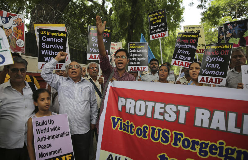 Activists of various left organizations denounce American policies while protesting against the upcoming visit of U.S. Secretary of State Mike Pompeo to India, in New Delhi, India, Tuesday, June 25, 2019. Pompeo is scheduled to travel to India after having visited Saudi Arabia and the United Arab Emirates, on a trip aimed at building a global coalition to counter Iran. (AP Photo/Altaf Qadri)
