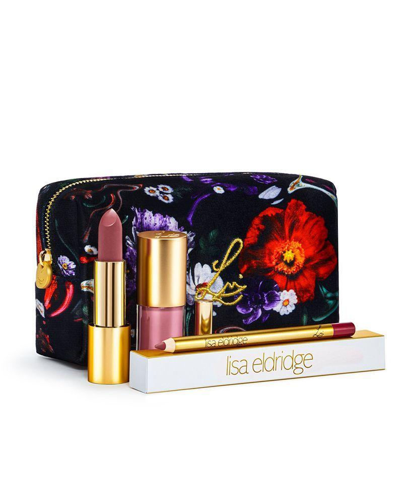 """<p><a class=""""link rapid-noclick-resp"""" href=""""https://www.lisaeldridge.com/products/velvet-beauty-kit-fantasy-florals-lip-kits"""" rel=""""nofollow noopener"""" target=""""_blank"""" data-ylk=""""slk:SHOP NOW"""">SHOP NOW</a></p><p>When the make-up artist legend first launched her own line of lipsticks they were as hard to get hold of as Glasto tickets but this Christmas, Lisa has released some epic sets for all the beauty lovers on your gifting list. </p>"""