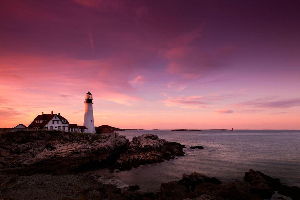 <p>Shades of pink and purple fill the sky over the Portland Head Lighthouse in Portland, Maine // June 03, 2013</p>