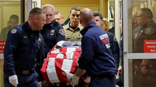 PHOTO: The body of a Kittitas County Sheriff's deputy is draped with a U.S. flag as it is carried out of Kittitas Valley Healthcare Hospital, March 20, 2019, in Ellensburg, Wash. (Ted S. Warren/AP)