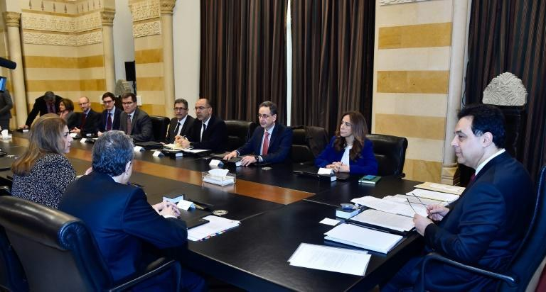 A handout picture provided by the Lebanese photo agency Dalati and Nohra on February 19, 2020 shows Prime Minister Hassan Diab (R) meeting with a delegation from the International Monetary Fund (IMF) at the Grand Serail in Beirut (AFP Photo/-)