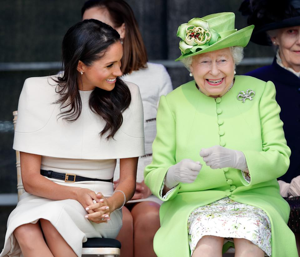 Meghan pictured with the queen on an engagement in 2018. (Photo: Getty Images)