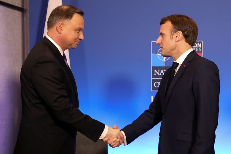 FILE PHOTO: France's President Emmanuel Macron greets Poland's President Andrzej Duda during a meeting at a NATO summit in Britain