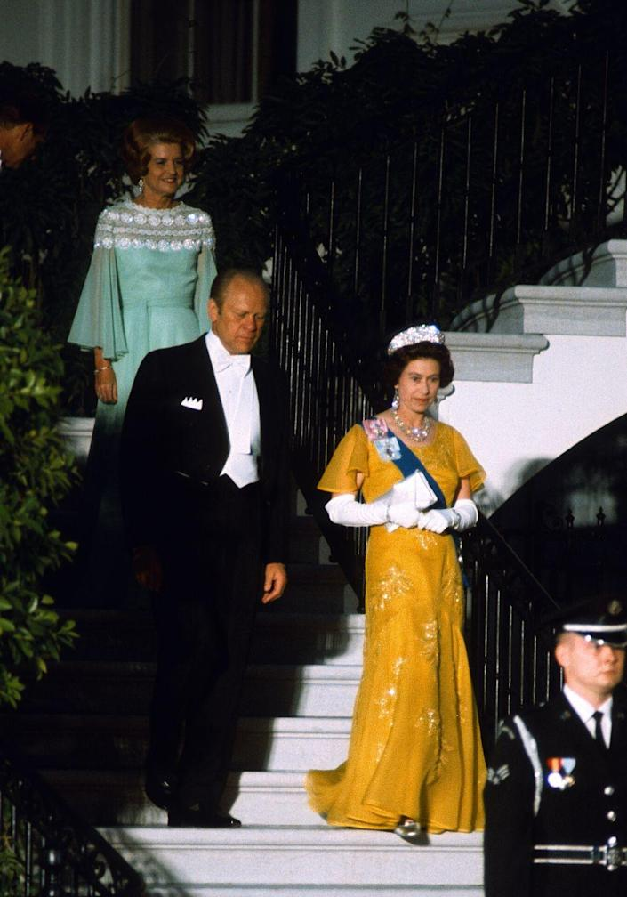 <p>During a state visit in Washington, D.C., Queen Elizabeth wore this bright yellow design for a formal dinner with President Ford. </p>