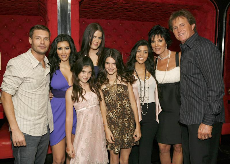 """Ryan Seacrest, Kim Kardashian, Kylie Jenner, Khloe Kardashian, Kendall Jenner, Kourtney Kardashian, Kris Jenner and Bruce Jenner pose for a photo at the """"Keeping Up With the Kardashians"""" viewing party at Chapter 8 Restaurant on October 16, 2007 in Agoura Hills, California."""