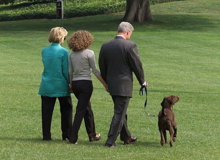 Bill and Hillary Clinton and their daughter Chelsea leave the White House with their dog Buddy on their way to Martha's vineyard on August 18, 1998, one day after his television address. (Photo by Luke Frazza / AFP via Getty Images)