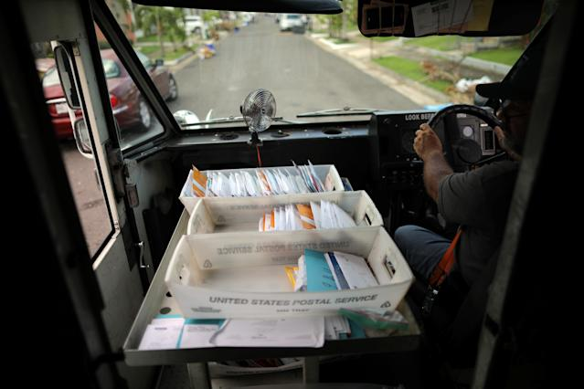 <p>Alfredo Martinez, a mail man for the U.S. Postal Service delivers the mail at an area affected by Hurricane Maria in San Juan, Puerto Rico, Oct. 6, 2017. (Photo: Carlos Barria/Reuters) </p>