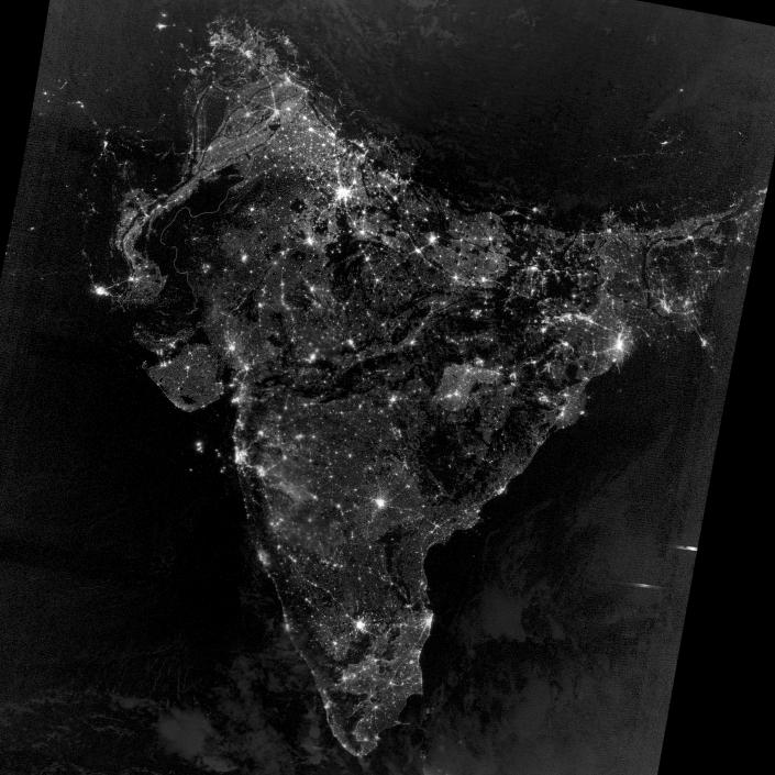 """On November 12, 2012, the Visible Infrared Imaging Radiometer Suite (VIIRS) on the Suomi NPP satellite captured this nighttime view of southern Asia. The image is based on data collected by the VIIRS """"day-night band,"""" which detects light in a range of wavelengths from green to near-infrared. The image has been brightened to make the city lights easier to distinguish. (NASA)"""