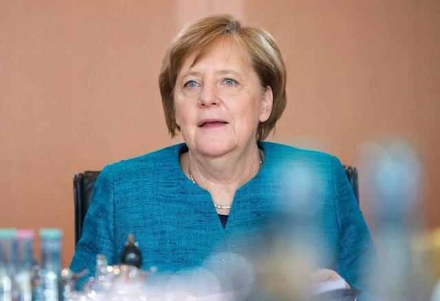 German Chancellor Angela Merkel has taken seat to lead the German government's weekly cabinet meeting at the Chancellery in Berlin on April 12, 2017 (AFP Photo/STEFFI LOOS)
