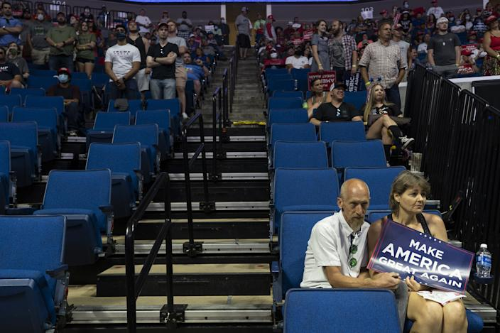 Attendees listen during a rally with U.S. President Donald Trump in Tulsa, Oklahoma, U.S., on Saturday, June 20, 2020. President Trump's first campaign rally since the coronavirus pandemic took hold in the U.S. drew far fewer supporters than the president and his advisers had predicted. (Photographer: Go Nakamura/Bloomberg/Getty Images)